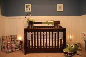 View of the primary wall, with crib.  We have two newborn photos on either side of his name.