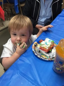 Enjoying his cake!