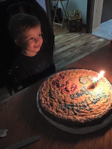 Blowing out his candles